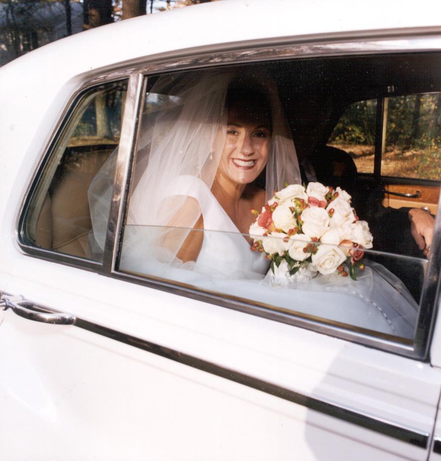 bride-looking-out-of-rolls_f4b0ed94-db8e-41c6-8a94-628e3cb3657f